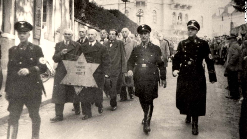 Nazi SS forces escort arrested Jewish men in Baden-Baden, Germany.