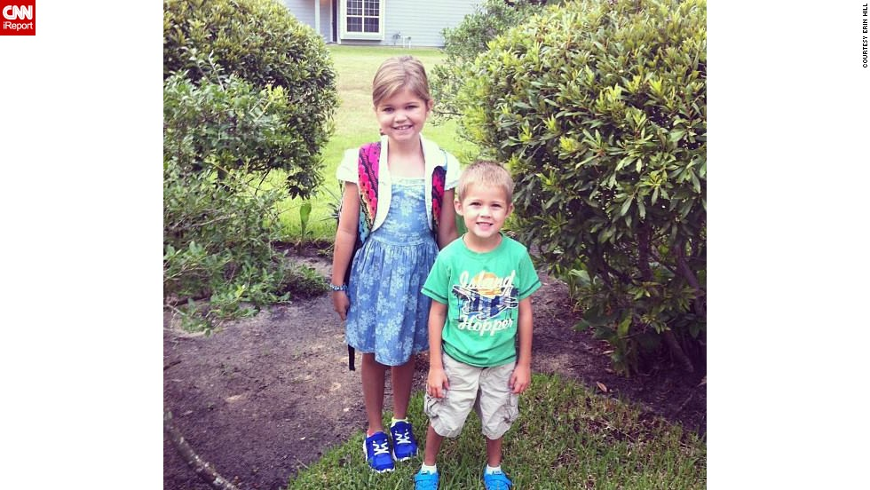 "Hill's children smile for their first day of school in 2013. Hill says she knows her kids are lucky ""in lots of ways."" Although Hill says she struggles with guilt, they are well cared for, have a lot of people who love them and ""my house feels like a happy home."""