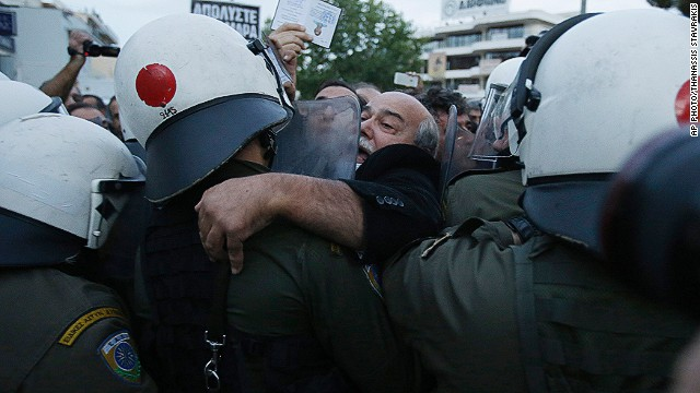 Riot police evict sacked Greek TV staff