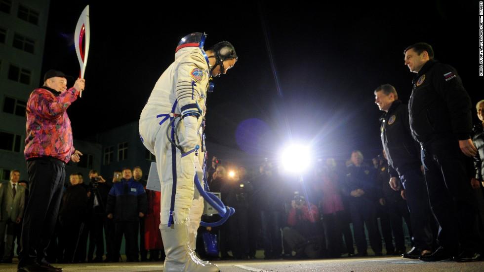 Japanese astronaut Koichi Wakata bid farewell to his family prior to liftoff. Wakata, Russian commander Tyurin and U.S. astronaut Rick Mastracchio accompanied the torch on its journey.