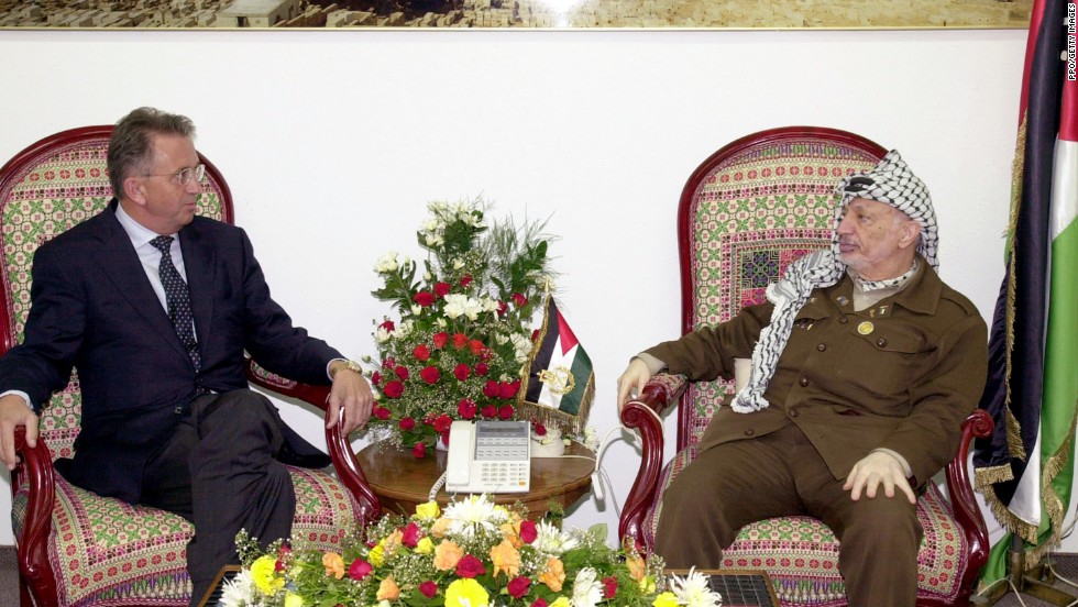 Arafat meets with United Nations Mideast envoy Terje Roed-Larsen in Gaza City on October 17, 2001. Arafat agreed to a cease-fire that would end several weeks of fighting between the Palestinian and Israeli armies.