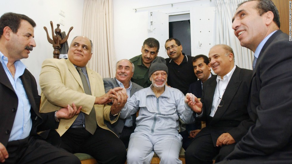 Arafat sits with aides and medical staff in Ramallah on October 28, 2004. The Palestinian leader's health was deteriorating, and he later sought medical treatment in Paris.