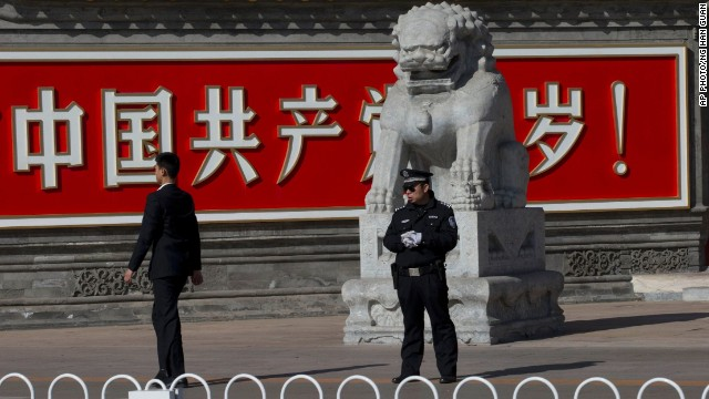 "A Chinese policeman stands near a sign that reads: ""Long live the Chinese Communist Party"" in central Beijing."