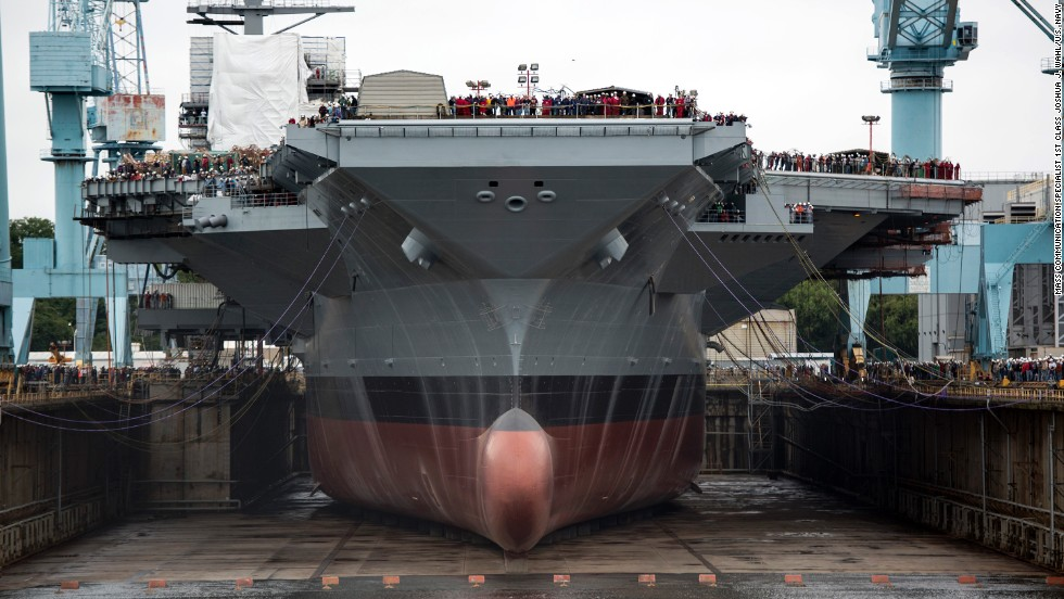 The USS Gerald Ford is the first of the Navy's newest class of aircraft carriers. Though the price of the 100,000-ton, 1,100-foot long behemoth is put at $13 billion, the Navy says the ship and others of the class will provide a savings of $5 billion over a Nimitz-class carrier during its 50-year lifespan.<br /> <br />The nuclear-powered Ford uses all electric utilities, meaning the steam catapults used to launch planes on the current Nimitz-class carriers are replaced with electromagnetic rails. The Ford is expected to be able to launch its aircraft at a rate 33% higher than Nimitz ships.<br /> <br />While the Navy says the massive carriers will be the backbone of the fleet for decades to come, some critics say improved weapons technology from U.S. adversaries could make them expensive vulnerabilities.<br /> <br />The Ford has many of its eventual crew of 4,500 aboard as its systems are tested. It is expected to be delivered to the Navy from Newport News Shipbuilding in Virginia in 2016.