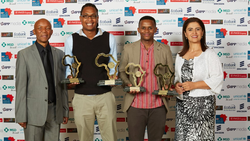 "The Overall Winners: Msindisi Fengu (centre left) and Yandisa Monakali (centre right) from Daily Dispatch in South Africa, won for their investigation series ""School Hostels of Shame."" The pair also jointly won the Print General News Award."