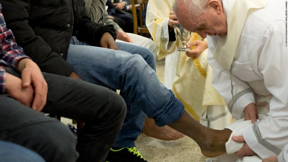 Pope Francis washes the feet of juvenile offenders, including Muslim women, as part of Holy Thursday rituals in March 2013. The act commemorates Jesus' washing of the Apostles' feet during the Last Supper.