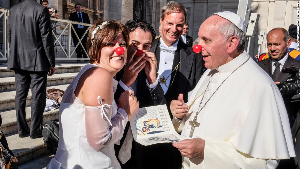 Pope Francis jokes with members of the Rainbow Association, which uses clown therapy in hospitals, nursing homes and orphanages. Many Catholics saw this image as the joyful flip side of Francis' embrace of the disfigured man.