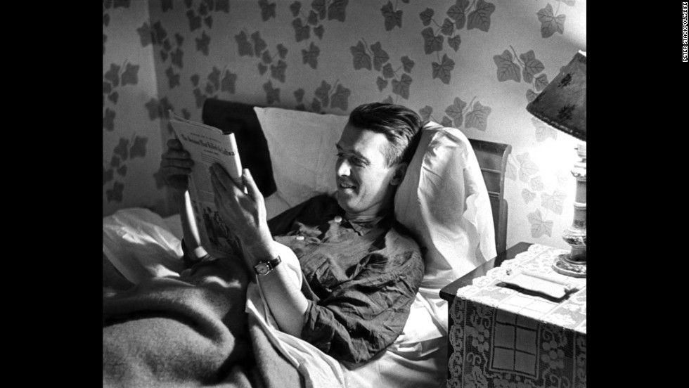 Stewart reads in bed at his parents' house.