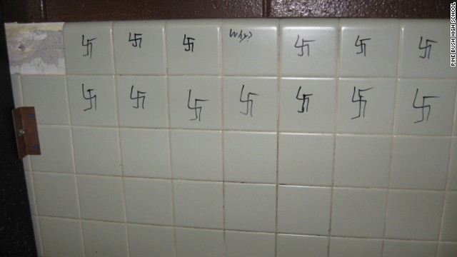 A photograph provided by Pine Bush High School shows swastikas drawn on a wall.