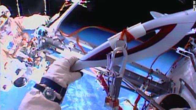 Sochi Olympic torch takes a spacewalk