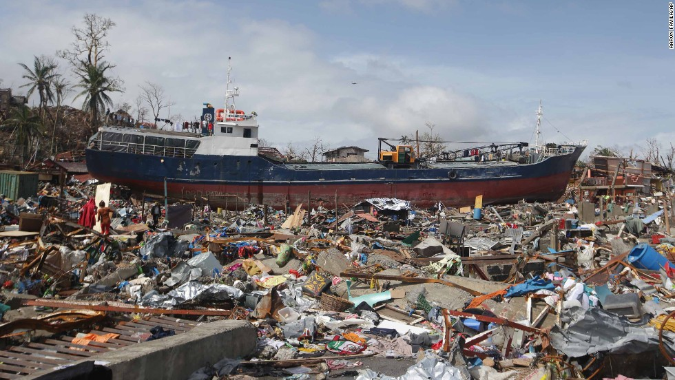 A large boat sits aground, surrounded by debris in Tacloban on November 10.