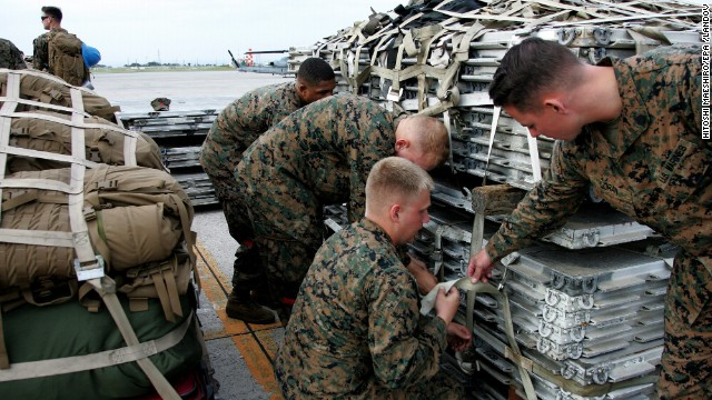 U.S. Marines at Marine Corps Air Station Futenma in Okinawa, Japan, check emergency and rescue supplies prior to their departure for Super Typhoon Haiyan hit areas in the Philippines on November 10.