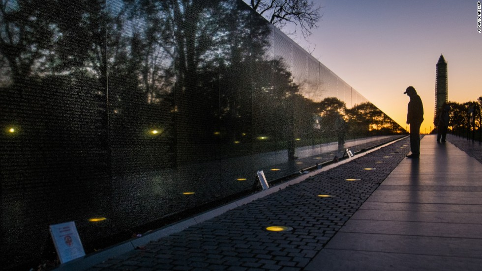 A man visits the Vietnam Veterans Memorial in Washington early Monday morning.