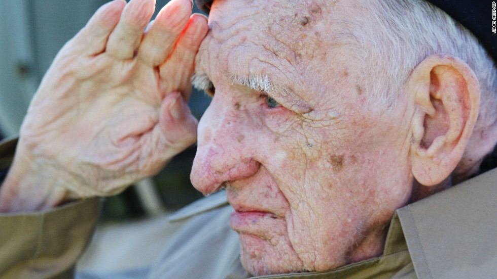 "Jesse Beazley, a World War II veteran and D-Day survivor, salutes during the national anthem before a college football game between Kentucky and Missouri in Lexington, Kentucky, on Saturday, November 9. <a href=""http://www.cnn.com/2013/11/08/showbiz/gallery/celebrity-vets/index.html""><br />Photos: Celebrities who served</a><a href=""http://cnnphotos.blogs.cnn.com/2013/11/08/every-bit-a-woman-every-bit-a-veteran/""><br />Photos: Female veterans</a>"