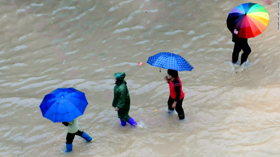 People make their way across a flooded street in Shangsi, China, on November 11. Haiyan moved toward Vietnam and south China after devastating the Philippines.