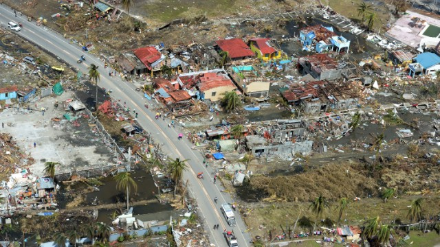 This aerial photo shows destroyed houses in the city of Tacloban, Leyte province, in the central Philippines on November 11, 2013, only days after Super Typhoon Haiyan devastated the town on November 8