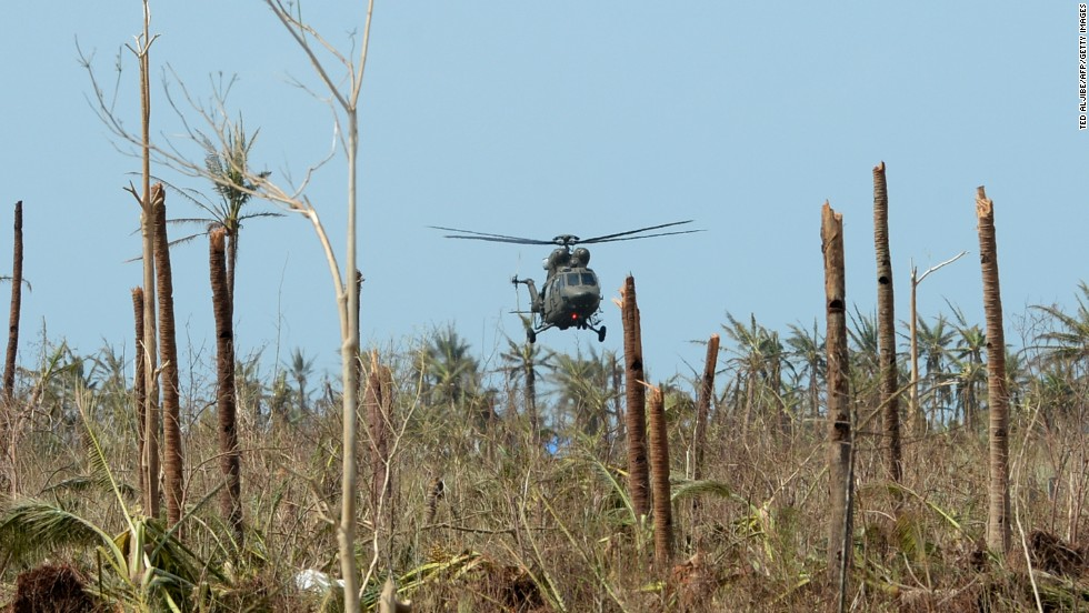 A military helicopter delivering food prepares to land at the airport in Guiuan on November 11.