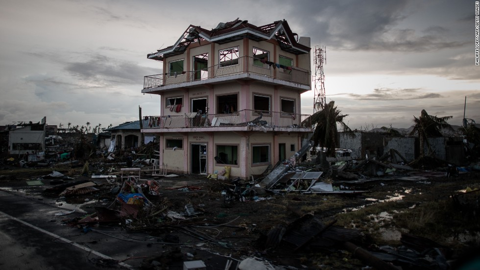 Debris lays scattered around a damaged home near the Tacloban airport on November 12.
