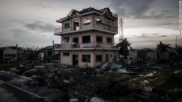 Debris lays scattered around a damaged home near the airport in Tacloban on November 12.