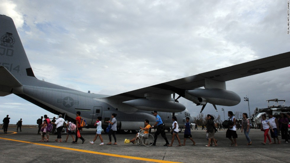 Typhoon survivors in Tacloban, Philippines, board a U.S. plane bound for the capital of Manila on November 11.