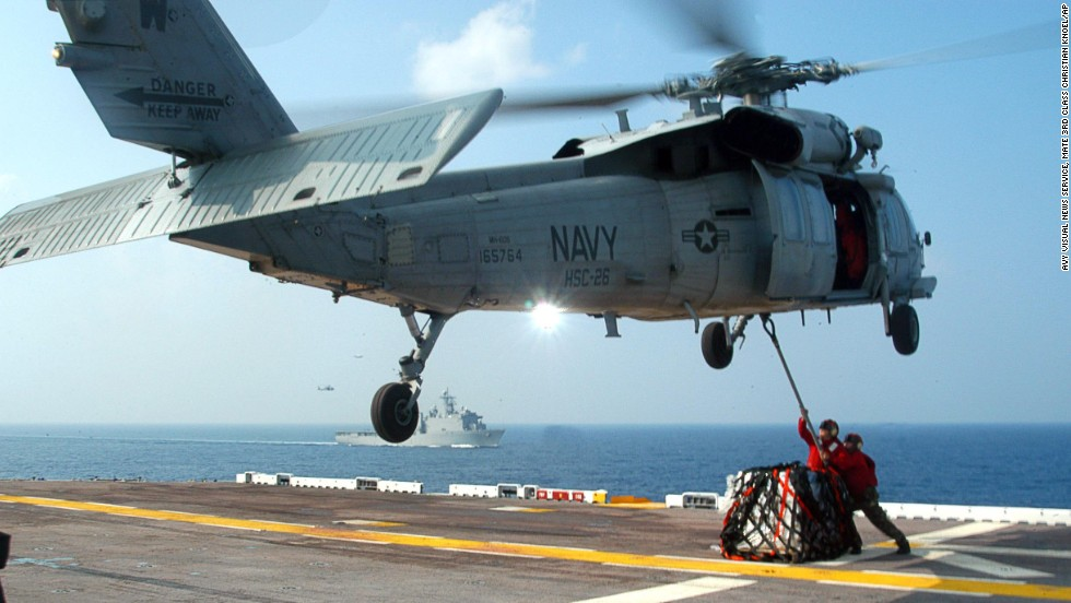 U.S. Navy personnel hook up supplies to a MH-60S Seahawk helicopter in this file photo from September 2005. Seahawk helicopters, which were used to provide relief to Hurricane Katrina victims, will now be brought to the Philippines to help.