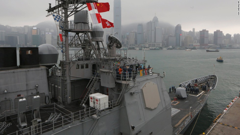 U.S. sailors of the USS Antietam stand on deck at Hong Kong's Victoria Harbor before sailing to the Philippines on November 12.
