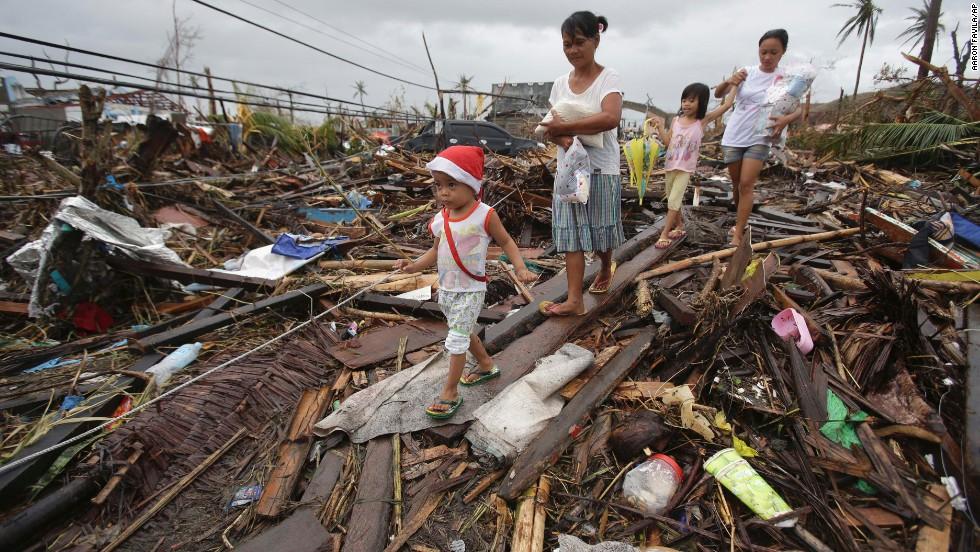 Survivors walk in Tacloban on November 12.