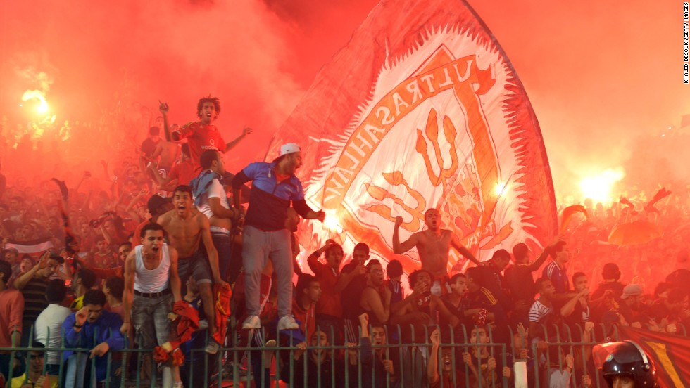 Fans of Al Ahly celebrate as the team nicknamed the Red Devils win a record eighth African club crown, beating South Africa's Orlando Pirates 2-0 on Sunday to take the final 3-1 on aggregate.