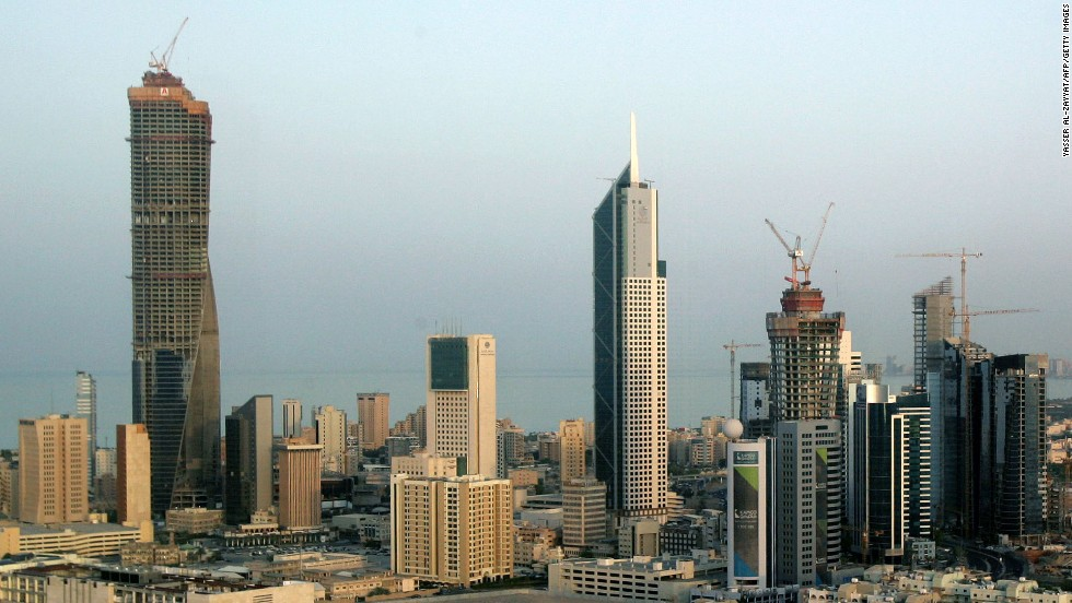Completed in 2011, Al Hamra Tower (left) in Kuwait City is shown here under construction in 2009. It rises to an architectural height of 1,354 feet (412.6 meters) and is occupied to a height of 1,218 feet (371.4 meters).