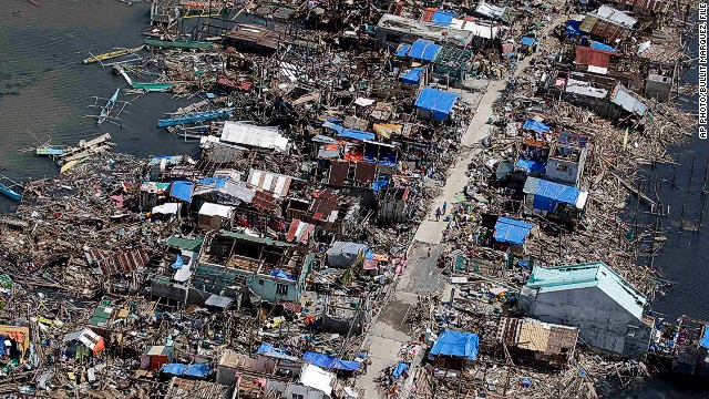 Photo taken from a Philippine Air Force helicopter shows the devastation of typhoon Haiyan in Guiuan, central Philippines on November 11, 2013.