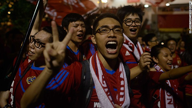Guangzhou Evergrande fans celebrate as they leave the stadium following their team's victory against FC Seoul in the AFC Champions League on Saturday.