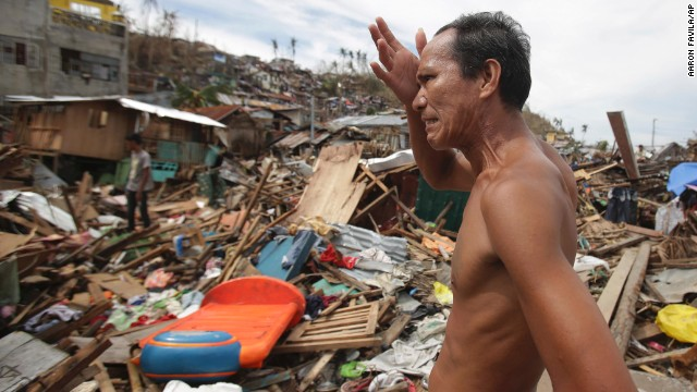 A man looks at his home destroyed by Typhoon Hayian in Tacloban, Philippines, on Wednesday, November, 13.