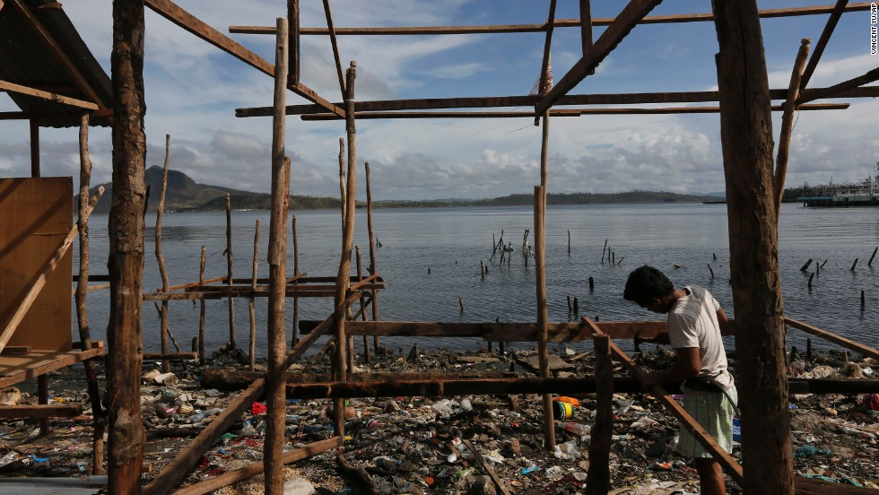 A survivor begins to rebuild his house in Tacloban on November 13.