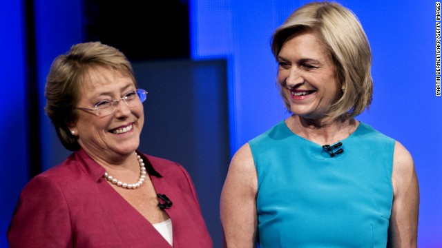 Chilean presidential candidates (L-R) Michelle Bachelet of the New Majority Coalition and Evelyn Matthei, of the right-wing Democratic Independent Union party smile before the start of a presidential candidate debate organized by ANATEL (Association of Broadcasters of Chile) in Santiago de Chile, on October 29, 2013. Chileans go to the polls in the first round of presidential elections on November 17.