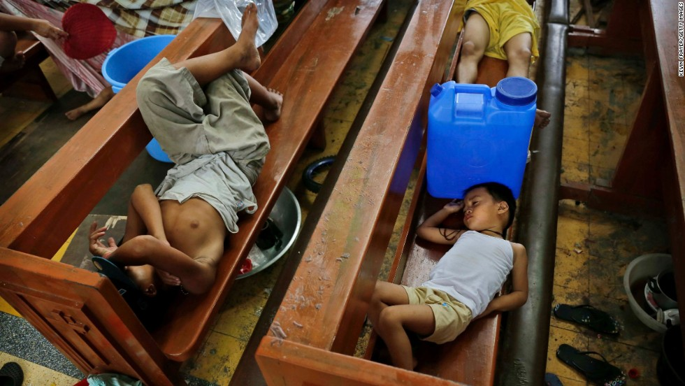 Residents take shelter in a church November 13 in Tacloban.