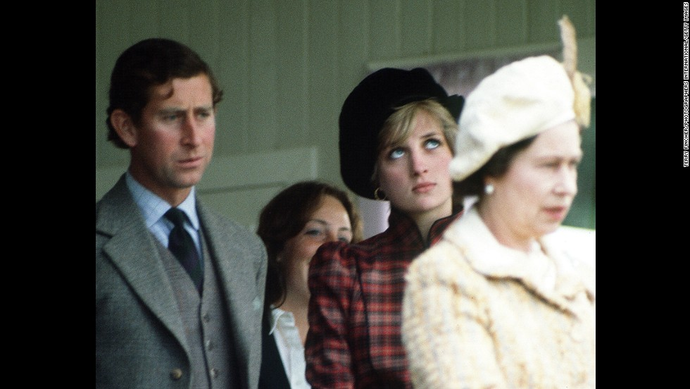 The prince and Princess Diana are seen behind the Queen during the Braemar Highland Games in Scotland in September 1981.