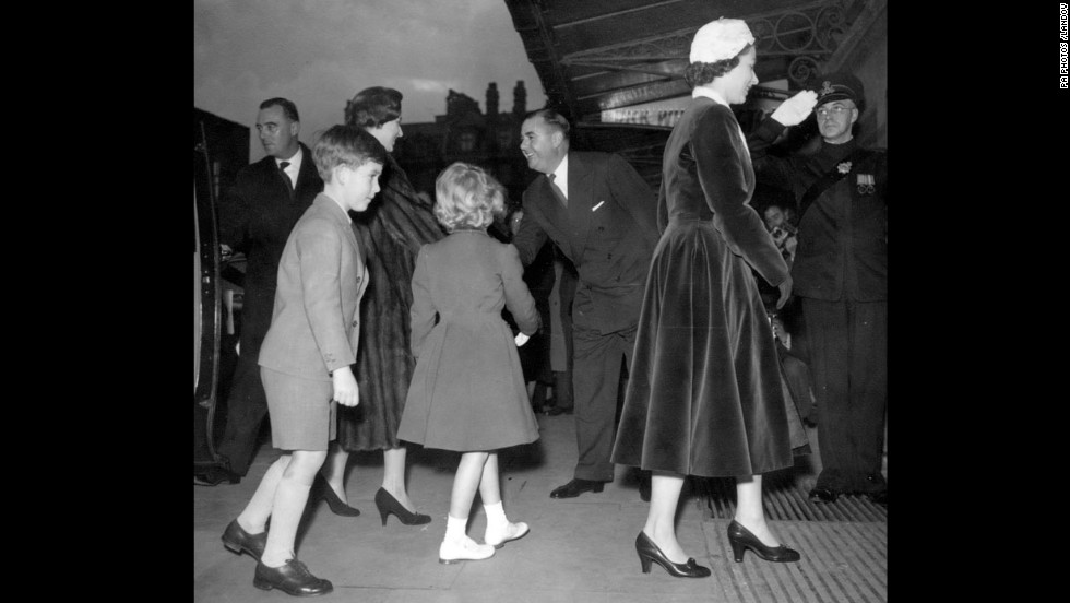 Prince Charles and Princess Anne follow their mother and Princess Margaret in London in 1956.