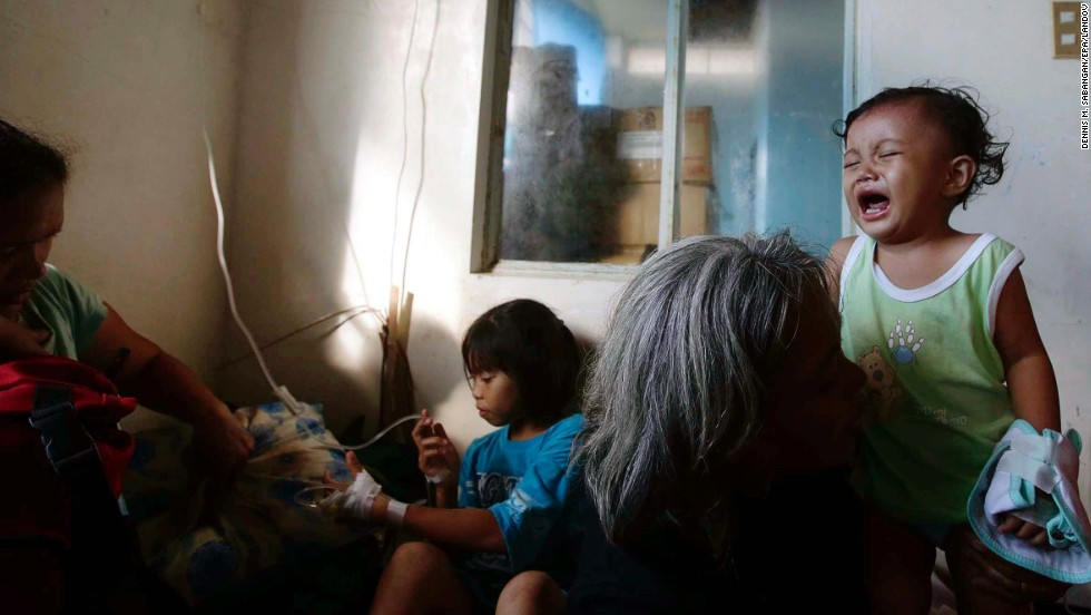 Survivors seek medical attention at a makeshift hospital inside an airport compound November 13 in Tacloban.