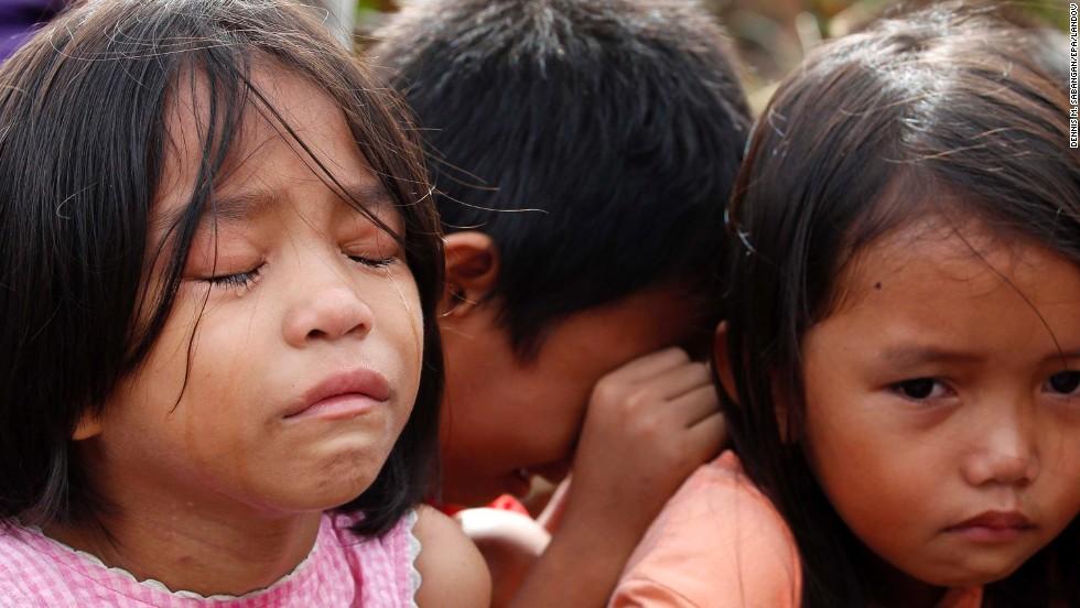 Children in Tacloban wait for social workers November 13.