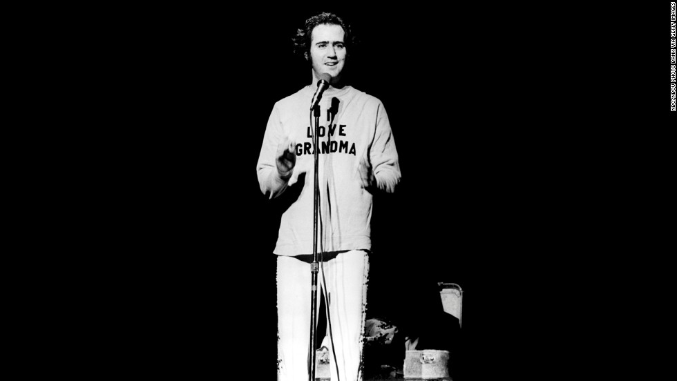 "Andy Kaufman onstage in 1977, wearing a ""I love grandma"" sweater after doing one of his trademark Elvis impersonations."