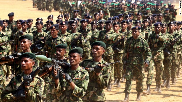 Sri Lankan military officers march during military parade rehearsals in preparation for the celebration of the third anniversary of the end of the civil war and the defeat of the separatist Tamil Tiger rebels on May 17, 2012 in Colombo, Sri Lanka.
