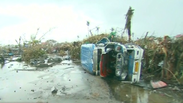 ac dnt cooper tacloban mourning_00021602.jpg