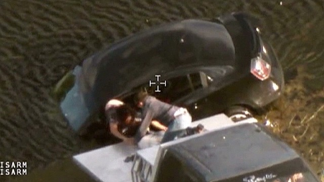 dnt woman rescued from car in pond_00013226.jpg