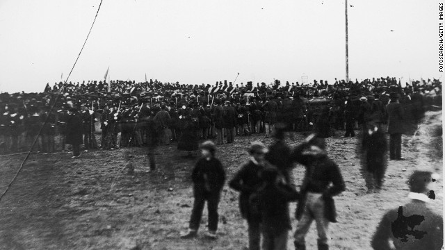 Crowds attend the dedication of the Gettysburg cemetery where Abraham Lincoln delivered his famous Gettysburg Address.