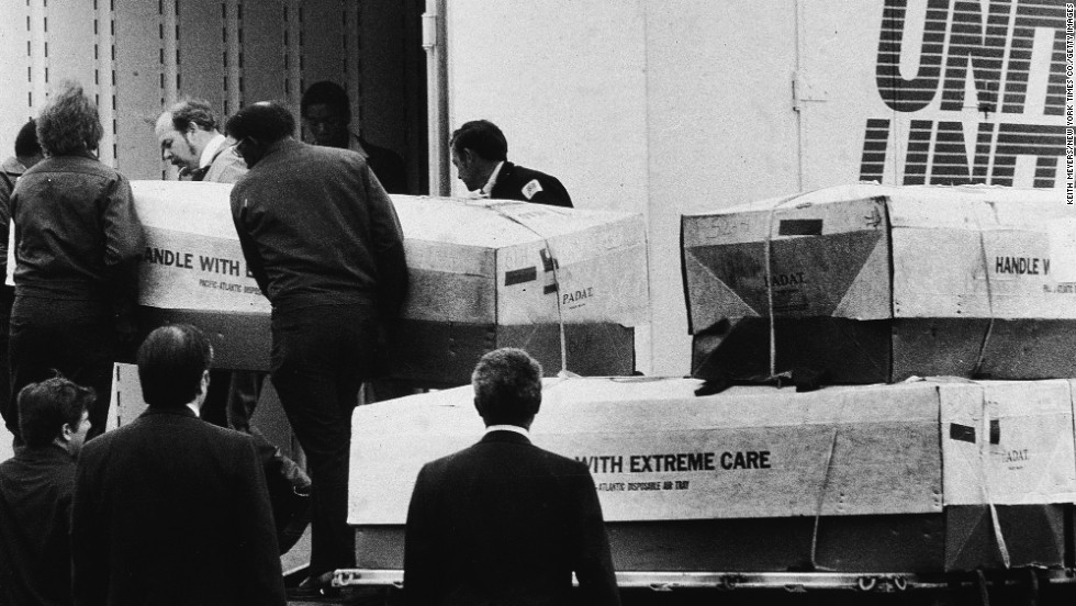 Men load coffins from Jonestown, into a transport truck in Dover, Delaware, on April 26, 1979.