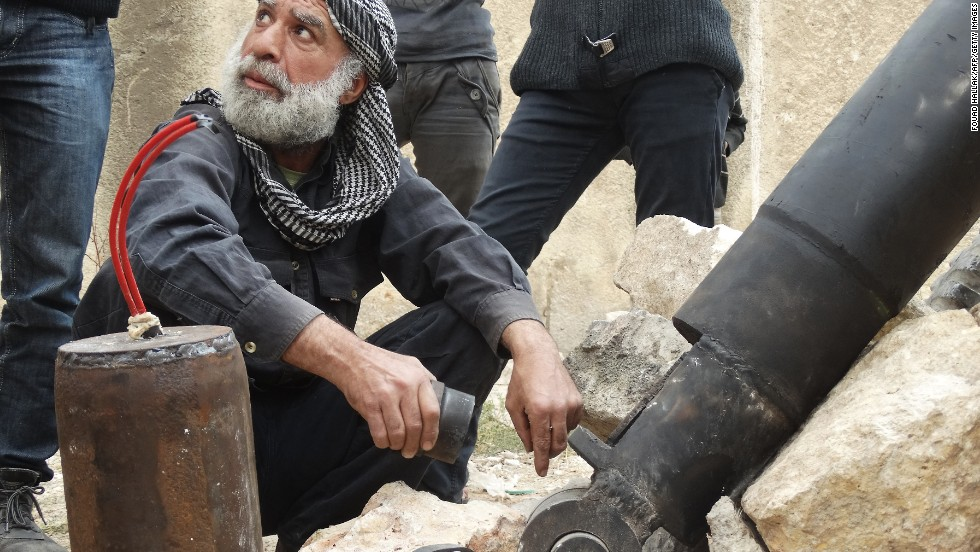 A rebel fighter prepares an improvised mortar shell in Aleppo, Syria, on Saturday, November 9.