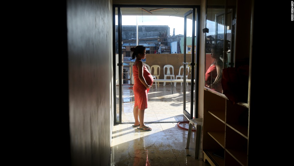 A pregnant survivor waits to give birth in a hospital November 16 in Tanauan.