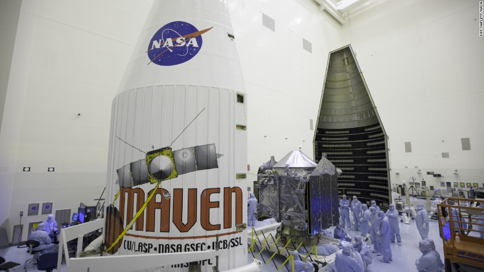 "Engineers and technicians work on MAVEN in November at NASA's Kennedy Space Center in Florida. ""After 10 years of working on this, I can't tell you how excited I am to see this finished spacecraft ready to go,"" said the mission's principal investigator, Bruce Jakosky."