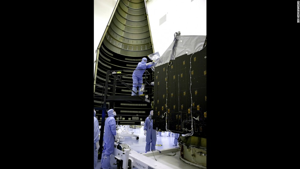 Workers in November get MAVEN ready to be placed inside the nosecone that will protect it during launch. NASA says the project will cost $671 million.