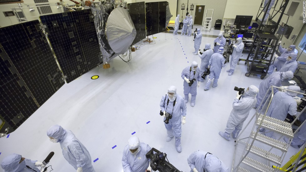 Reporters and photographers wear protective gear as they get a look at the MAVEN spacecraft. Wingtip to wingtip, MAVEN is the same length of a school bus -- 37.5 feet.